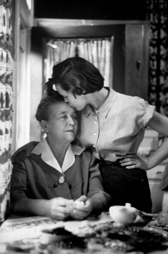 "Jill Corey giving her grandmother, ""Mamouch"", a kiss on the forehead. 1953."
