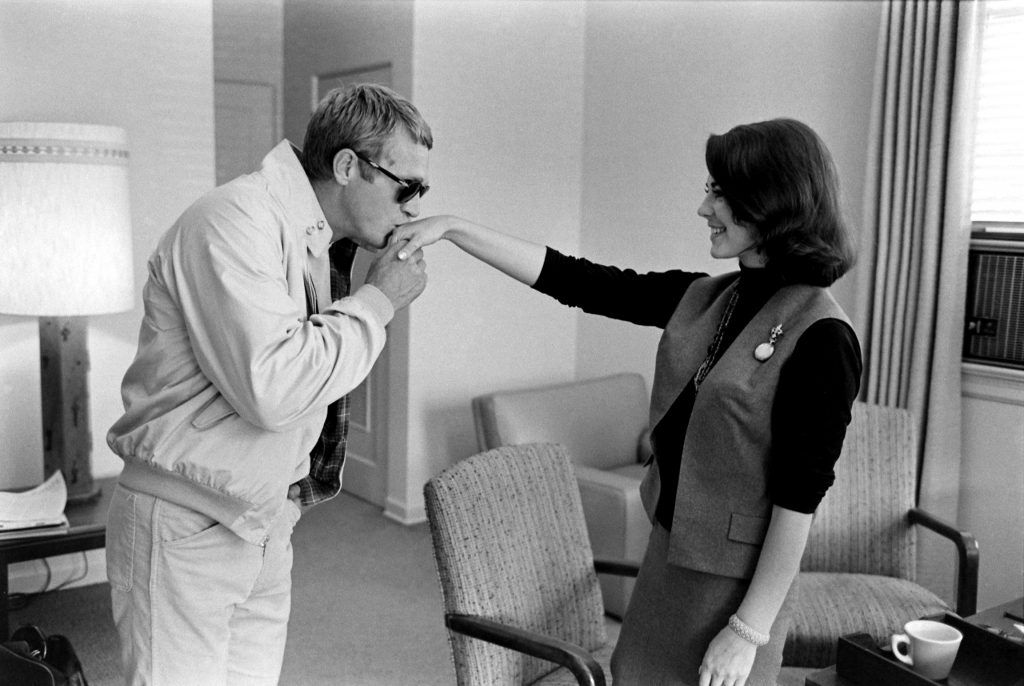 "Steve McQueen kisses Natalie Wood's hand as the actors meet to discuss their new big-screen project, 1963's ""Love With the Proper Stranger."""
