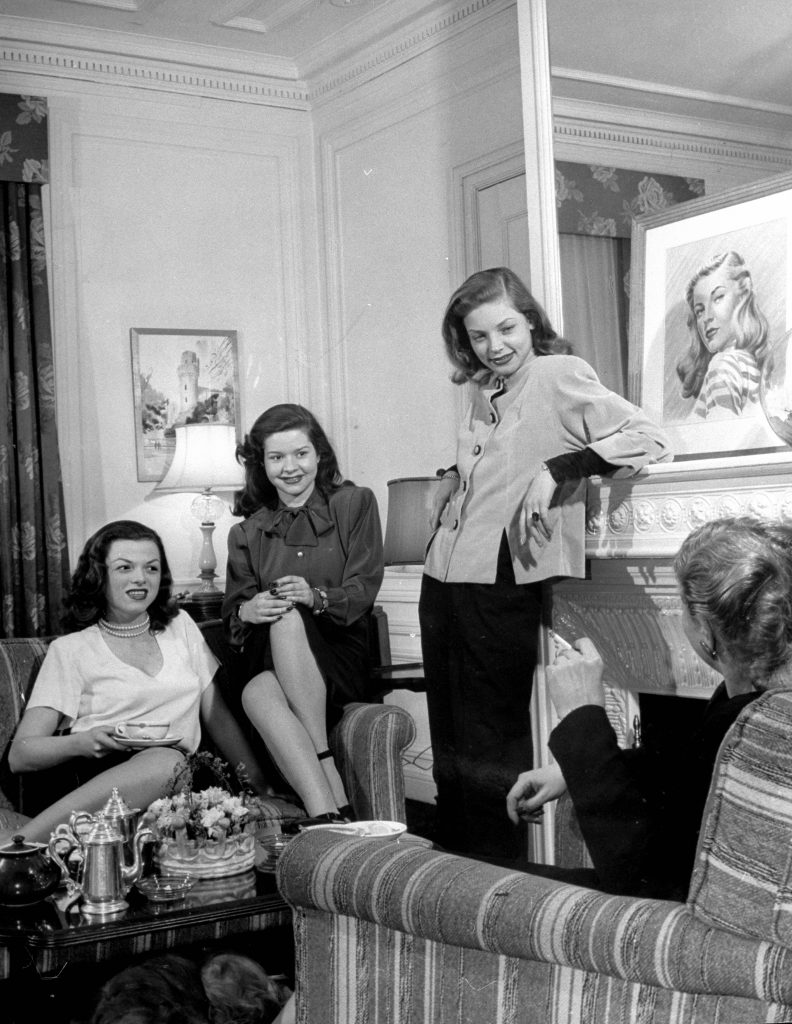 Lauren Bacall with friends at the Gotham Hotel, 1945.