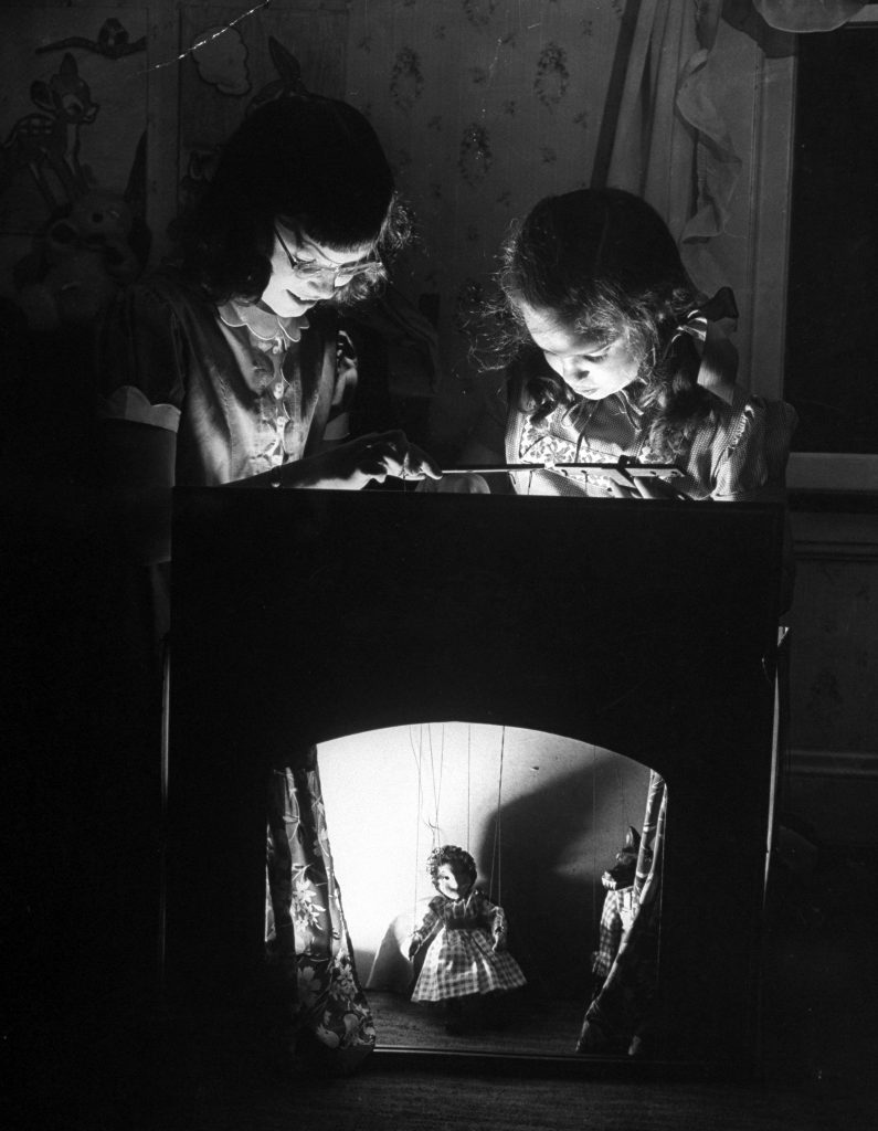 "Suzy Creech and friend, typical 10 year-old girls known as ""pigtailers"" playing ""Red Riding Hood,"" 1946."