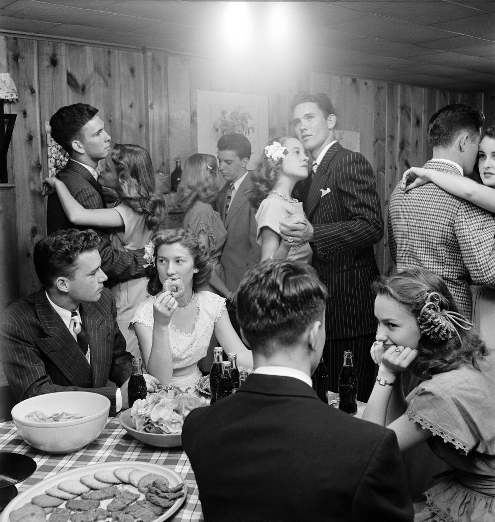 Teenagers dancing and socializing at a party, 1947.