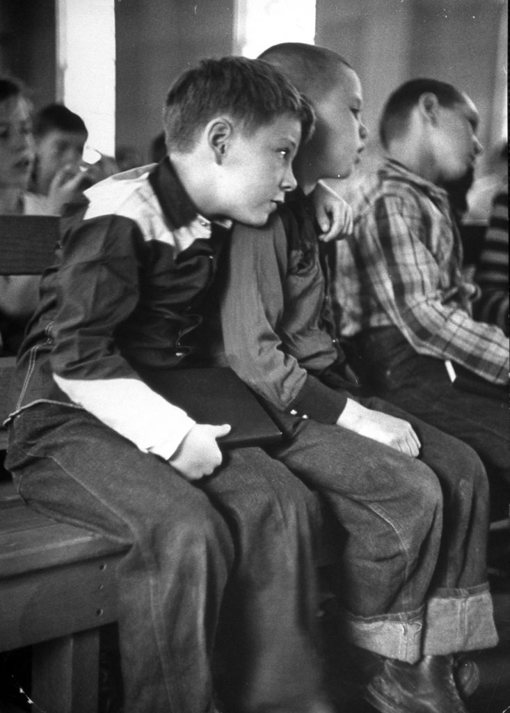 Young Richard Dale (L) beginning to adjust to his new environment when he finds a new friend, Ernest, during chapel services at boy's ranch.