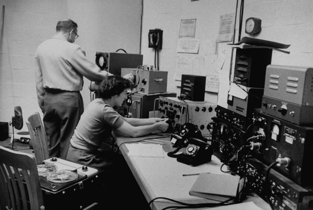 Scientists of the National Bureau of Standards Boulder Laboratory listening to signals from Sputnik I.