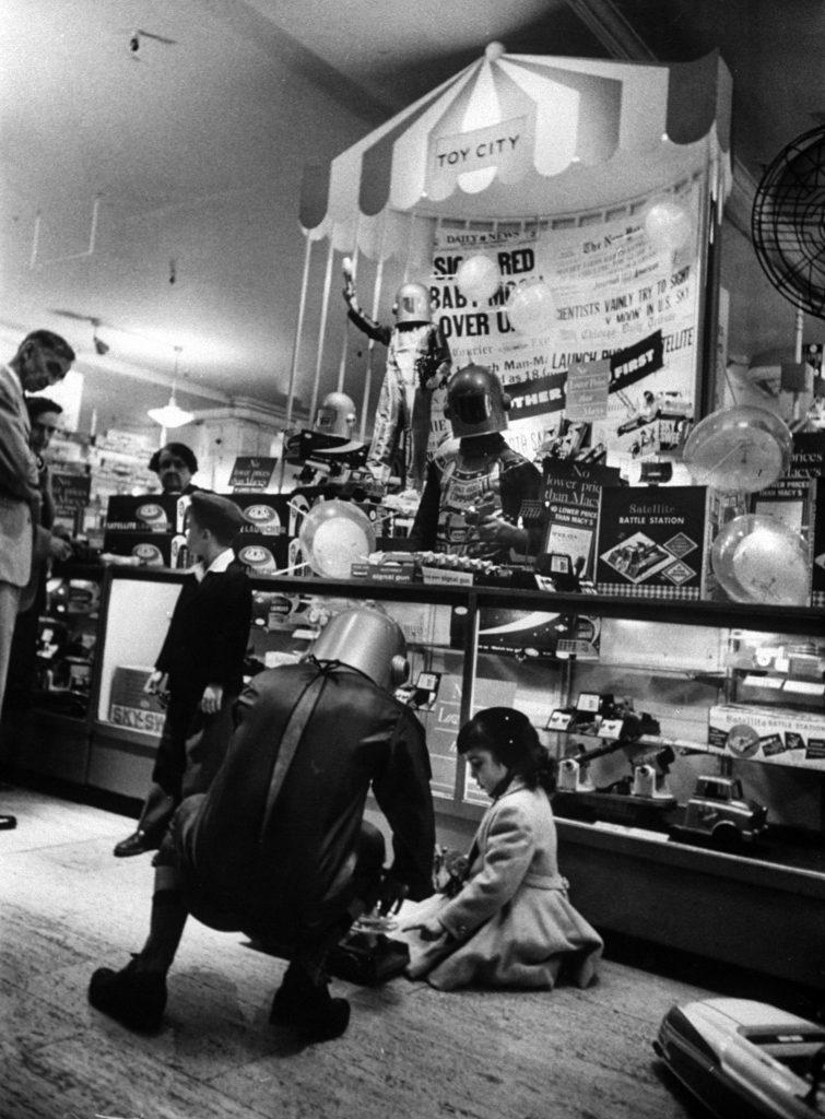 Macy Dept. Store clerks in space helmets