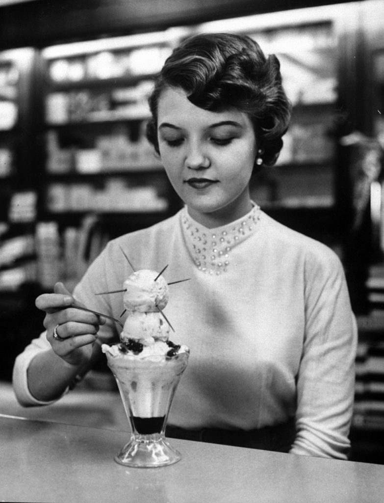 Young woman eating a Sputnik sundae.
