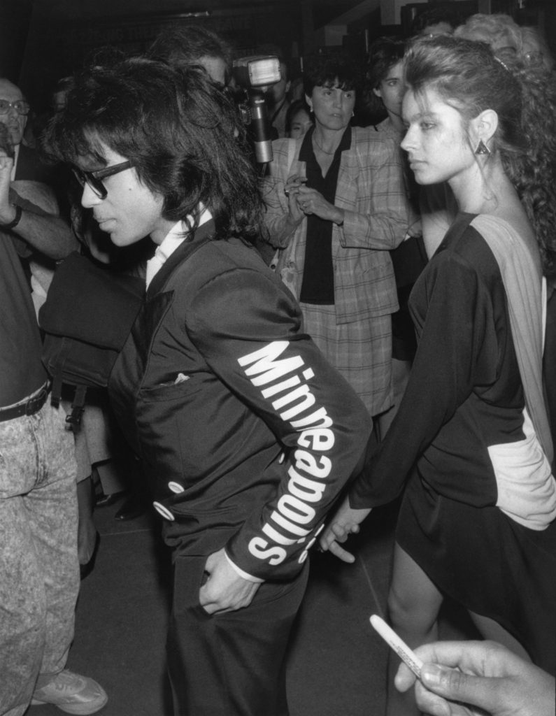 "Musician Prince and an unidentified girlfriend are attending ""M Butterfly"" on Broadway. He is wearing a jacket with Minneapolis printed on the sleeve which is trademarked for his ""Love Sexy 88 tour"". New York, NY, September 23, 1988."